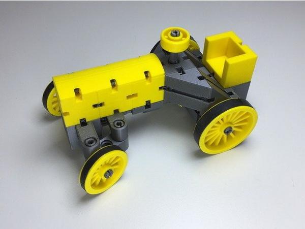 желтый трактор на 3д принтере